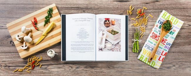 Product campaign photograph of cook book and utensils