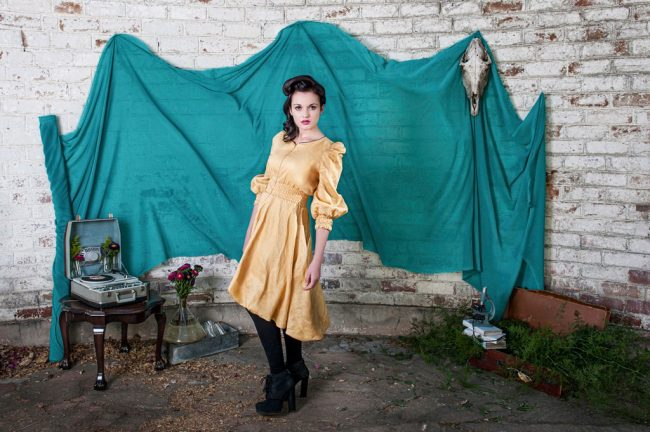 High fashion editorial mad scientist girl wearing yellow Burgundy-Fly dress with experiment jar and skull by Natalie Field