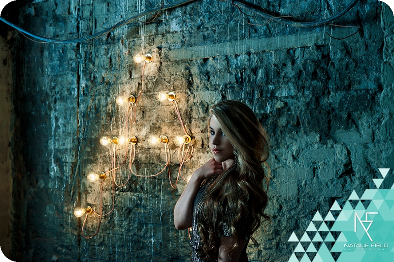 album cover art celebrity portraiture of singer songwriter ashlinn gray in front of lightbulbs