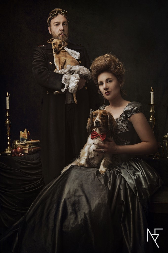 baroque styled shoot conceptual portraiture of couple with dogs on set by Natalie Field Photography
