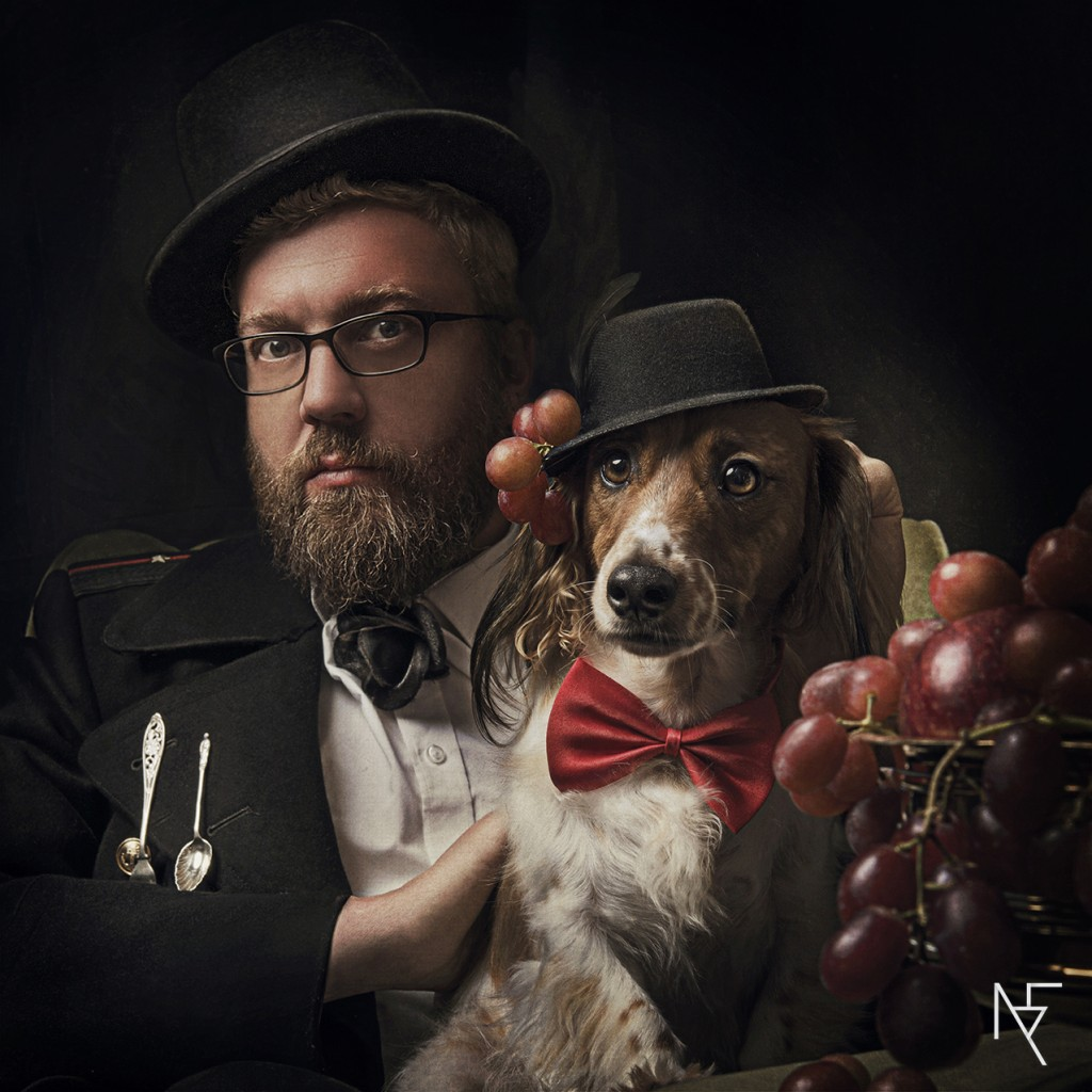 concepetual portraiture male with dog wearing hat lit with chiaroscuro lighting by Natalie Field