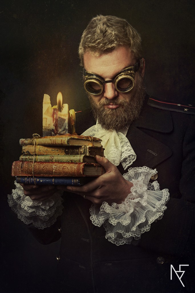 baroque styled shoot conceptual portraiture male with steampunk goggles on set by Natalie Field Photography