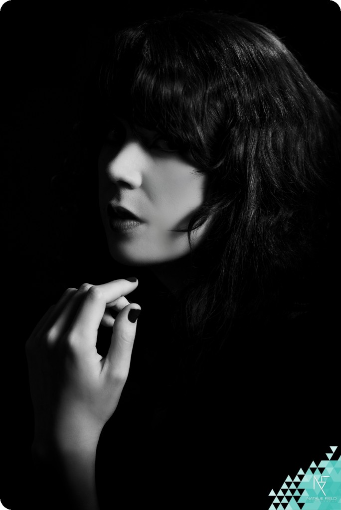 Low key portrait of female model in black and white by Natalie Field Photography