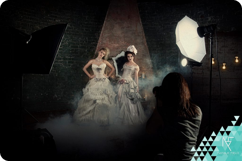 Behind the scenese on a fashion set with Natalie Field, Photon lighting on two models dressed in Immagika gowns surrounded by smoke