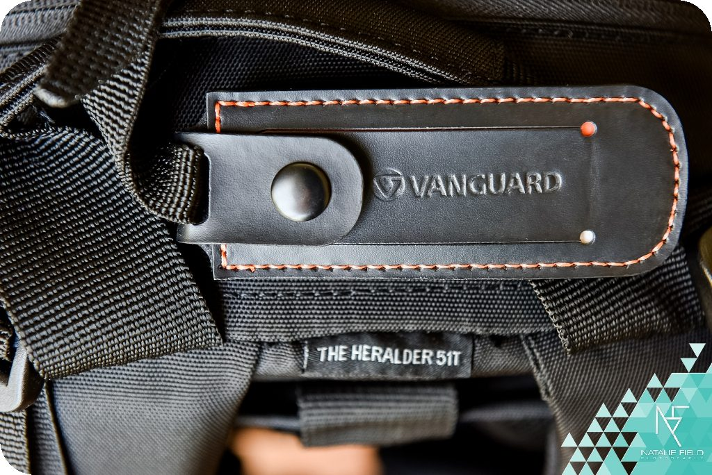 Vanguard Heralder 51T product review showing branded name tag of camera bag, images by Natalie Field.