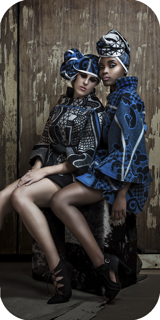 Fashion photography gallery of high fashion stylized fashion photography represented with two models wearing Kobo collection coats and head pieces by Natalie Field Phtoography