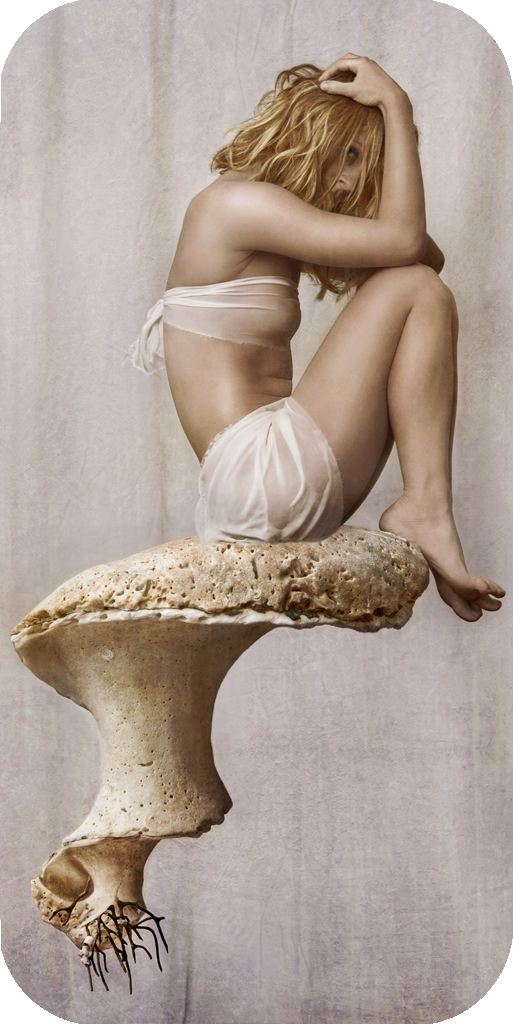 conceptual fine art portraiture surreal scene with yogi sitting on shell by conceptual yoga and fine art photographer Natalie Field in South Africa