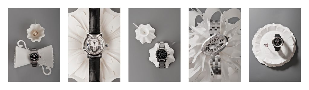 Editorial photography of watches and jewelry styled with paper art for Dossier magazine by Johannesburg fashion photographer Natalie Field